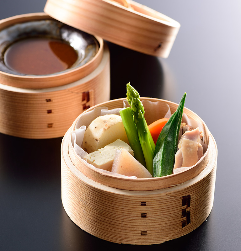 Steamed vegetables in a bamboo basket